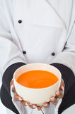 Chef serving soup Royalty Free Stock Images