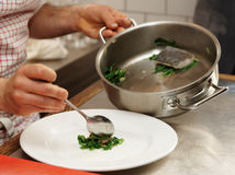 Chef is serving steamed dish Royalty Free Stock Photography