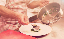 Chef is serving steamed seabass, toned Royalty Free Stock Image