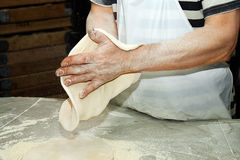 Chef shaping pizza dough. Closeup of Chef's hands preparing pizza dough Royalty Free Stock Photos