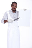 Chef with a sharp knife Stock Photography