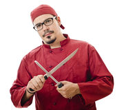 Chef sharpening a knife Stock Images