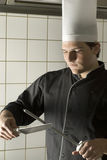 Chef Sharpening Knives Royalty Free Stock Image