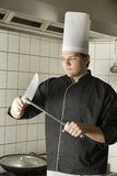 Chef Sharpening Knives Stock Images