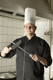 Chef Sharpening Knives Royalty Free Stock Photos