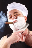 Chef shaves with chopper Royalty Free Stock Photos