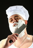 Chef shaves with chopper Royalty Free Stock Photography