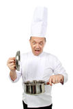 Chef shocked. Looking at the pot cooking a wrong food Stock Photos