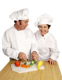 Chef Shool - Class Clown. Two chefs laughing and joking on the job.  Isolated on white Royalty Free Stock Image