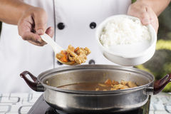 Chef shovel Japanese pork curry with steam rice Royalty Free Stock Image