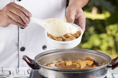 Chef shovel Japanese pork curry with steam rice Stock Photo
