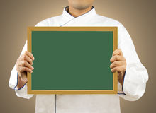Chef showing chalkboard Stock Photo