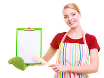 Chef showing clipboard with empty blank for text recommended menu Stock Photo