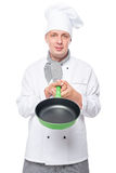 Chef showing empty pan in the studio Royalty Free Stock Photo