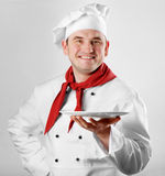 Chef showing empty plate Stock Images