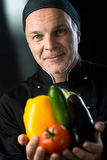 Chef showing fresh vegetables Stock Photo