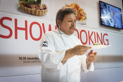 Chef showing his creation at Golosaria 2013 in Milan, Italy Stock Images