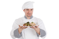 Chef showing and holding a plate of prepared food Stock Photos