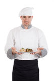 Chef showing and holding a plate of prepared food Stock Photography