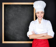 Chef showing menu blackboard Stock Image