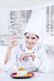 Chef showing perfect sign with delicious dish Royalty Free Stock Photo