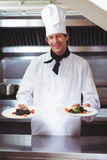 Chef showing plates of spaghetti Stock Image