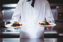 Chef showing plates of spaghetti Royalty Free Stock Photo