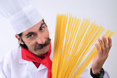 Chef showing spaghetti. And smiling Royalty Free Stock Images