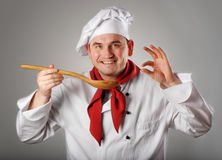 Chef showing spoon Royalty Free Stock Photography