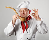 Chef showing spoon Royalty Free Stock Photo