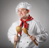 Chef showing spoons Stock Images