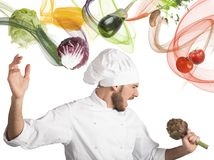 Chef sings. With an artichoke as microphone Stock Photo