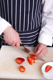 Chef slice strawberries Royalty Free Stock Photography