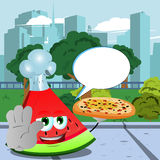 Chef slice of watermelon with pizza holding a stop sign in the city park with speech bubble Royalty Free Stock Images
