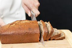 Chef Slicing Banana Bread Stock Photos