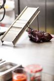 Chef slicing boiled beetroot Royalty Free Stock Photos