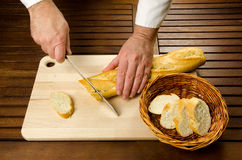 Chef slicing bread, hands detail Stock Photo