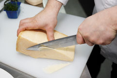 Chef is slicing cheese Stock Image