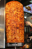 Chef slicing Chicken Doner Kebab at local restaurant in Beyoglu Stock Photo