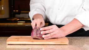 Chef slicing or cutting beet Stock Photos