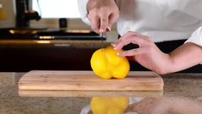 Chef slicing or cutting celery on cutting board stock video
