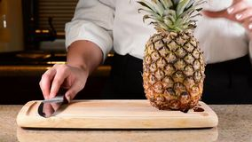 Chef slicing or cutting pineapple Royalty Free Stock Photo
