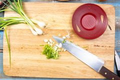 Chef slicing ginger before cooking Stock Photo