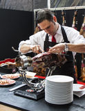 Chef slicing jamon iberico Stock Images