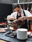 Chef slicing jamon iberico. Chef slicing jamon (prosciutto, ham Stock Images