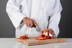 Chef Slicing Red Bell Pepper Royalty Free Stock Photo