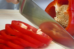 Chef Slicing A Red Pepper With Sharp Knife Stock Photography