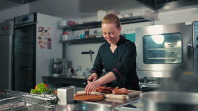 Chef slicing sausages on the cutting board. Chef slicing sausages, frankfurters on the cutting board stock video footage