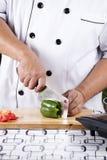 Chef slicing Tomato Royalty Free Stock Photo