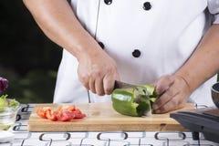Chef slicing Tomato Stock Photography